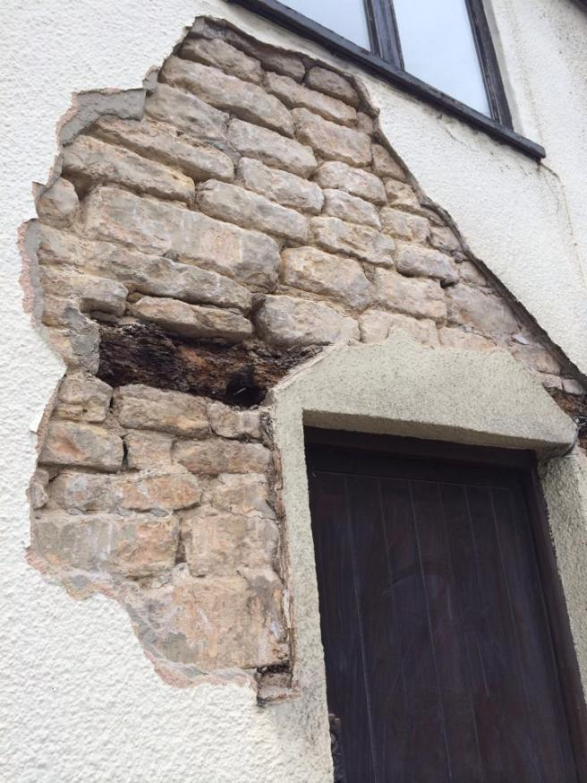 The cotswold stone and original lintel revealed
