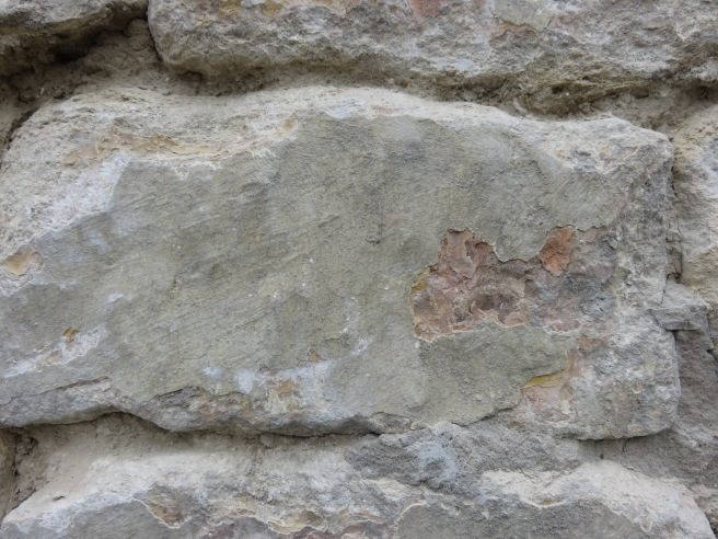 Cement left on stone face