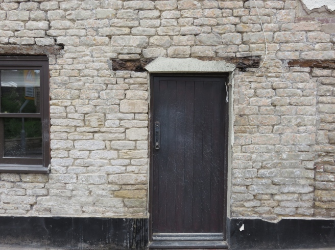 Cleaned up vertical section of stone down left side of door